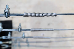 The wire clippings screw locked cable pole. Metal turn buckle fastening of cable Stock Images