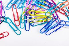 Wire colorful paperclips stack on white background stock photo