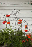 Wire Cowboy, Poppies and Green Party Lights Stock Image