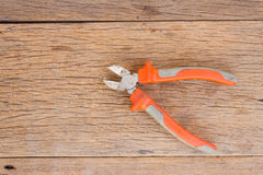 Wire cutter on wood background Royalty Free Stock Photo