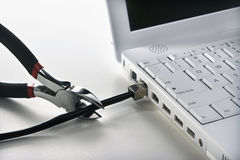 Wire Cutters Cutting Cable to Laptop Stock Photo