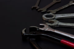 Wire cutters, pliers and wrench. Low key Tools on darkness background stock image