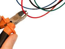 Wire cutting. Cutting red wire by wire cutters. Safety precautions, bomb neutralization stock images
