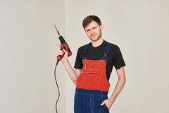 Wire electric screwdriver in hand stock images