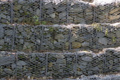 Wire Enclosed Tiered Rocks To Control Erosion Royalty Free Stock Image