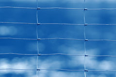 Wire fence. With blue background royalty free stock photo