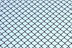 Wire fence. With blue sky Stock Photo