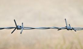 Wire fence. On the road way Royalty Free Stock Image