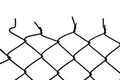 Wire fence. The top of a cut wire fence. The move from the consistent patterned shapes at the bottom, to twisted, skewed, cut shapes at the top Stock Photos