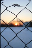 Wire fence and the basketball court,winter time Stock Images