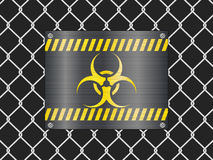 Wire fence and biohazard sign Stock Photos