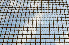 Wire fence with blue sky Royalty Free Stock Photo