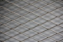 Fence mesh netting.Wire fence background. Seamless metal chain link fence. Royalty Free Stock Photos