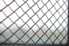 Fence mesh netting.Wire fence background. Seamless metal chain link fence. Royalty Free Stock Photography