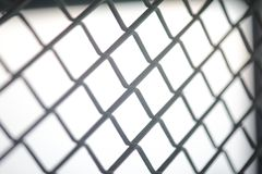 Fence mesh netting.Wire fence background. Seamless metal chain link fence. Stock Image