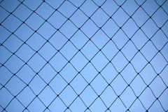 Fence mesh netting.Wire fence background. Seamless metal chain link fence. Stock Images