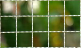 Fence mesh netting.Wire fence background. Seamless metal chain link fence. Stock Photography