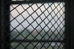 Fence mesh netting.Wire fence background. Seamless metal chain link fence. Stock Photo