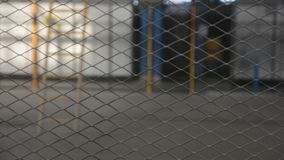 Wire fence. Closeup of steel net. Steel mesh stock video footage