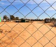 Wire fence. With a construction site on the background stock photography