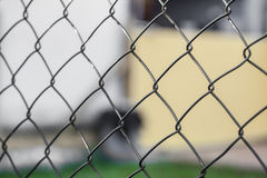 Wire fence & x28;cyclone fencing& x29; in repeating patterns Stock Photo