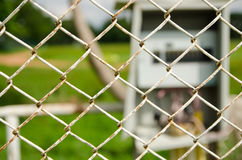 Wire fence with electrical control box on background Stock Images