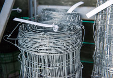 The wire fence. Fencing for sheep. Metal wire fence for sheep royalty free stock image