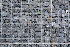 Wire fence filled with stones Stock Images