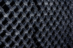 Wire fence frozen. Black background Royalty Free Stock Photos