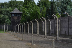 Wire fence and guard post in Auschwitz Royalty Free Stock Photography