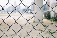 Wire fence with Hong kong cityspace. Vintage filter stock photo