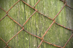 Wire fence rust texture background with wood. Wire fence rust texture background with mossy wood Stock Photo