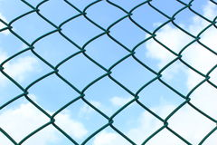 Wire fence on sky background Royalty Free Stock Photography