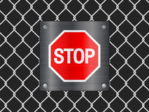 Wire fence and stop sign Stock Photo