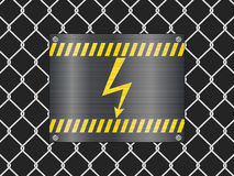 Wire fence and voltage sign Stock Images