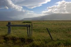 Wire fence and the woodden gate in iceland highlands Royalty Free Stock Images