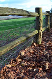 Wire fencing on wooden farm fence. Stock Photography