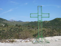 Wire frame cross with hills in the background. Stock Photos