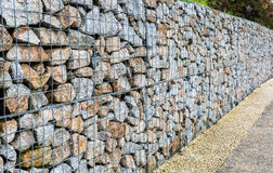 Wire Gabion Rock Fence. Metal Cage filled with rocks. Royalty Free Stock Photos