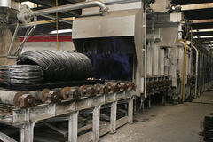 Wire hardening machine. Wire hardening process and installation in a factory Stock Images
