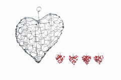 Wire heart with smaller ones with red beads Royalty Free Stock Photo