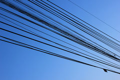 Wire line. And background blue sky Royalty Free Stock Image