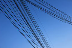 Wire line. Crossing and background blue sky Royalty Free Stock Photos