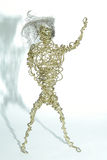 Wire Man with Hair. An scupture I made with brass wire and hair Waving to you stock image