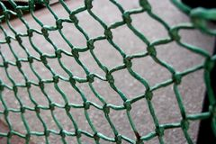 Wire mesh. A green wire mesh stock photo