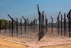 Wire mesh and barbed wire. Royalty Free Stock Photography