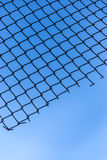 Wire mesh of blue sky background Stock Images