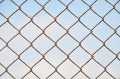 Wire mesh a closeup on background blue sky royalty free stock photography