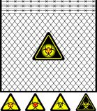 Wire mesh fence and biohazard sign Stock Photos