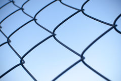 Wire mesh fence with blue sky background Stock Photos